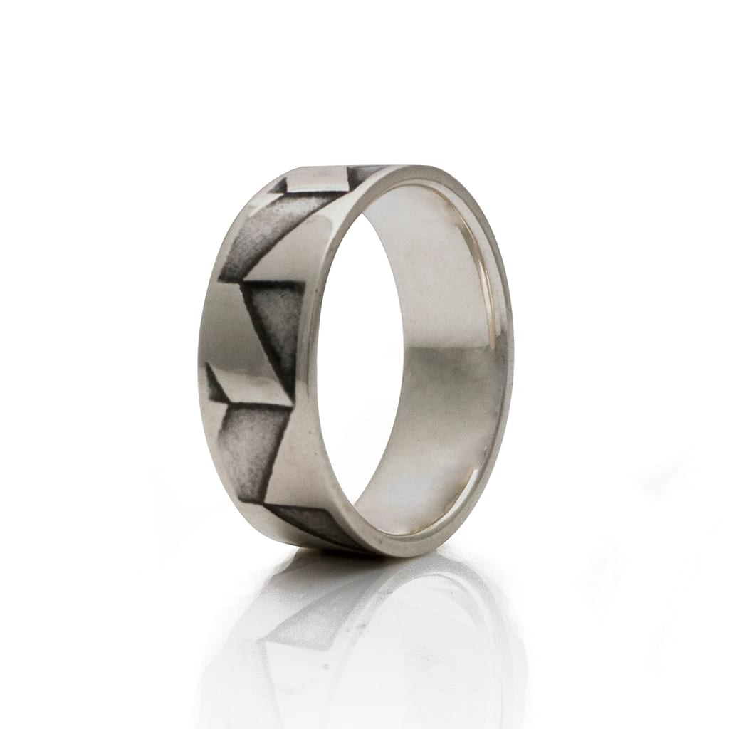 silver ring with abstract design
