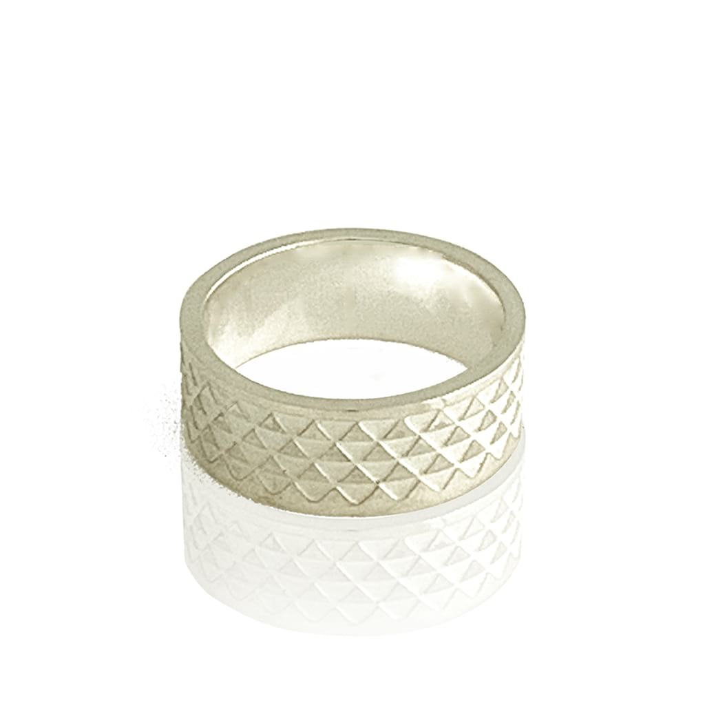 triangle ring highly polished flat on white background