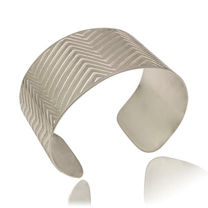 Wide Silver Oval Cuff With Etched Lines on a White Background Sideview