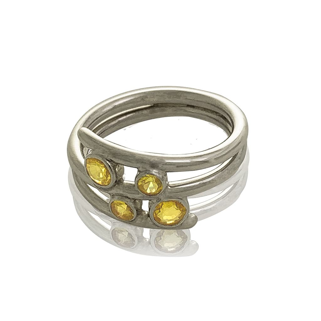 contemporary silver ring with yellow sapphires on a white background