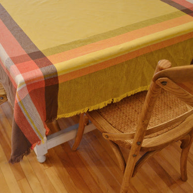 Orange-brown-yellow plaid vintage cotton tablecloth