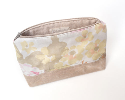 Water resistant floral waxed cotton makeup bag