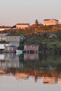 Pink sunset over fishing village in Newfoundland print
