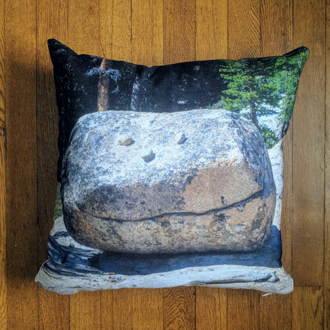 Throw pillow with smiling rock boulder