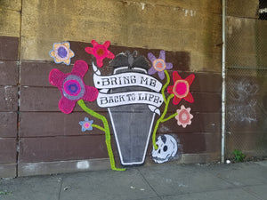 bring me back to life coffin crochet yarn wheat paste street art installation inphiltrate