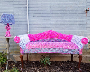 yarnbomb pink and blue crochet covered vintage couch and lamp
