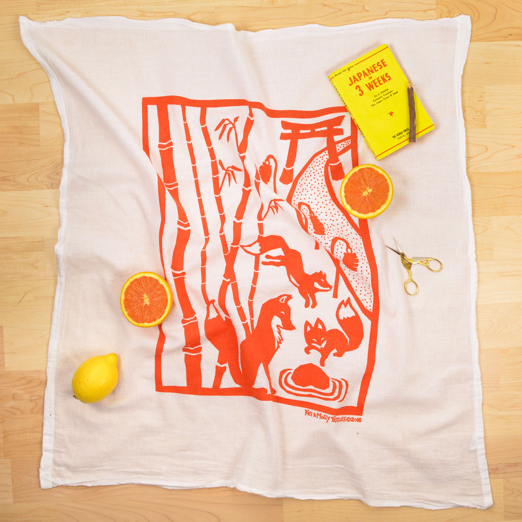 Kei & Molly Foxes Flour Sack Dish Towel in Burnt Orange with Props