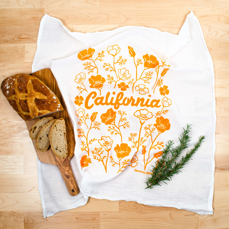 Kei & Molly California Poppies Flour Sack Dish Towel in Squash with Props