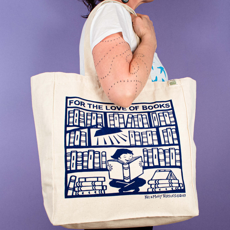 Kei & Molly Tote Bag with Books Design in Indigo Held by Model