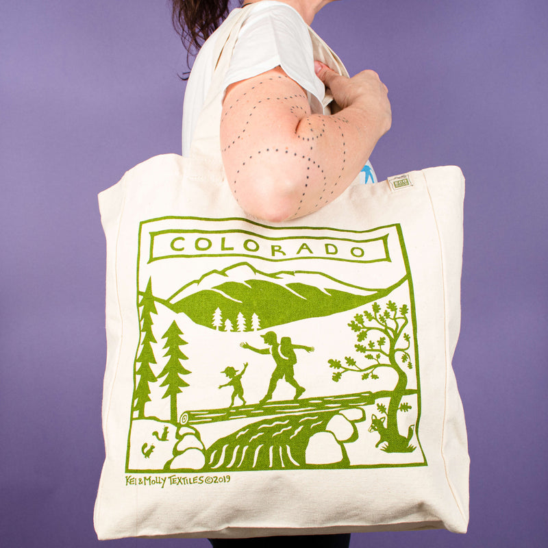 Kei & Molly Tote Bag with Colorado Design in Green Held by Model