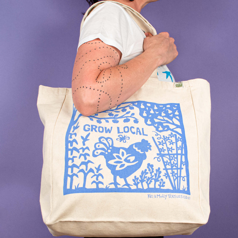 Kei & Molly Tote Bag with Grow Local Design in Sky Blue Held by Model