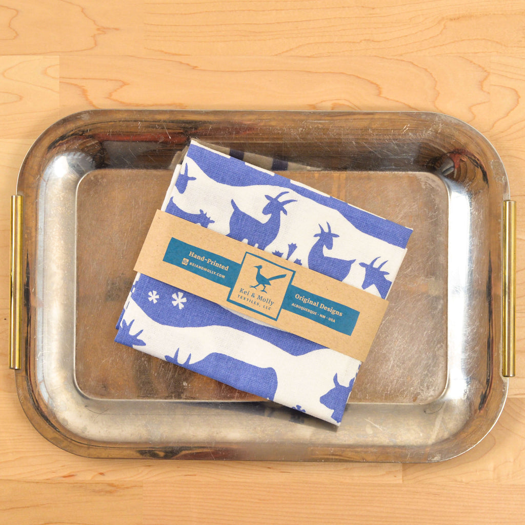Kei & Molly Linen/Cotton Tea Towel with Alps Design in Steel Blue Folded on Tray