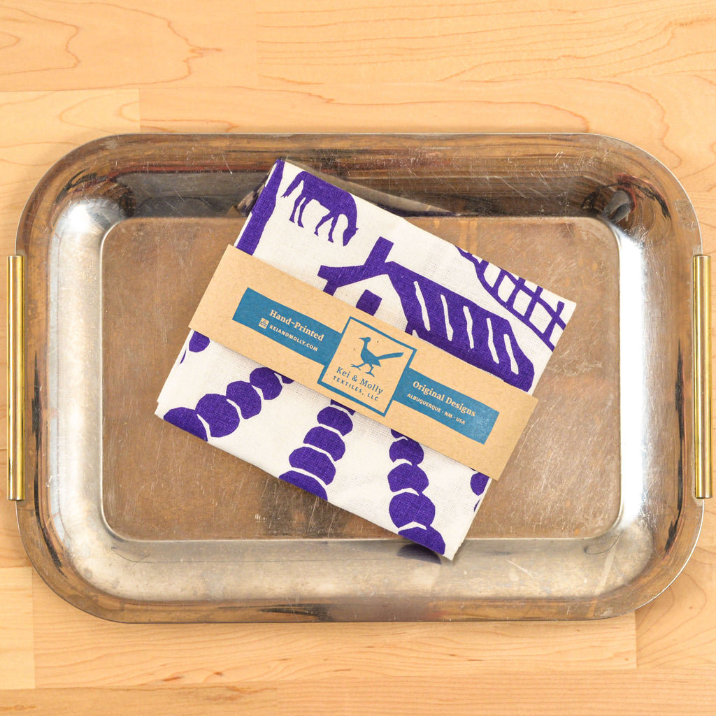 Kei & Molly Linen/Cotton Tea Towel with Lavender Farm Design in Purple Folded on Tray