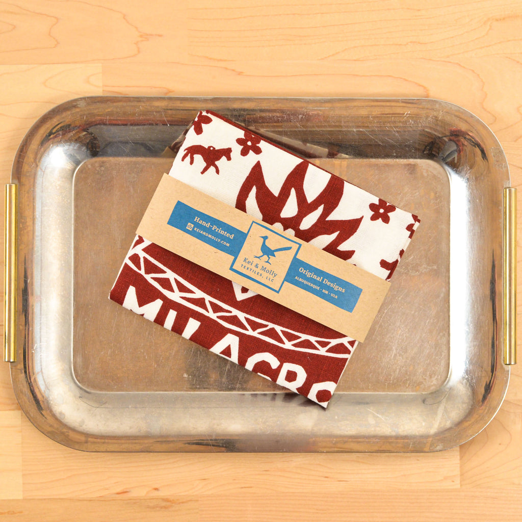 Kei & Molly Linen/Cotton Tea Towel with Milagro Design in Red Folded on Tray