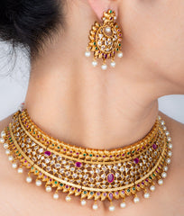 Gold finish choker with stones