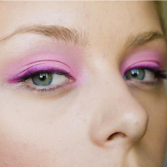 bold and beautiful eye shadow look with fun, bright, lilac eyeliner