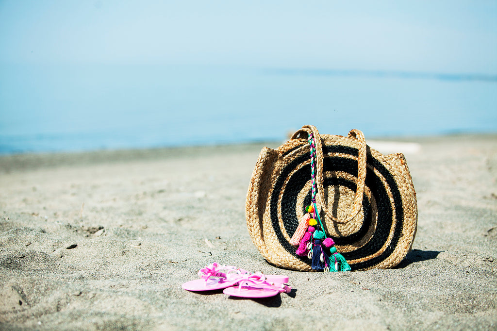 Coast of Cabo Jute Bag on the beach with a cute pair of pink flip flops