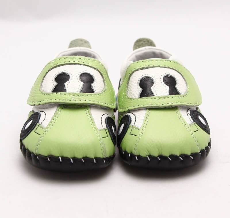 green leather baby sneakers car front view