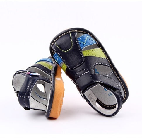 Dune navy leather toddler boy sandals with optional squeaky valves for encouraging heel toe walking pattern