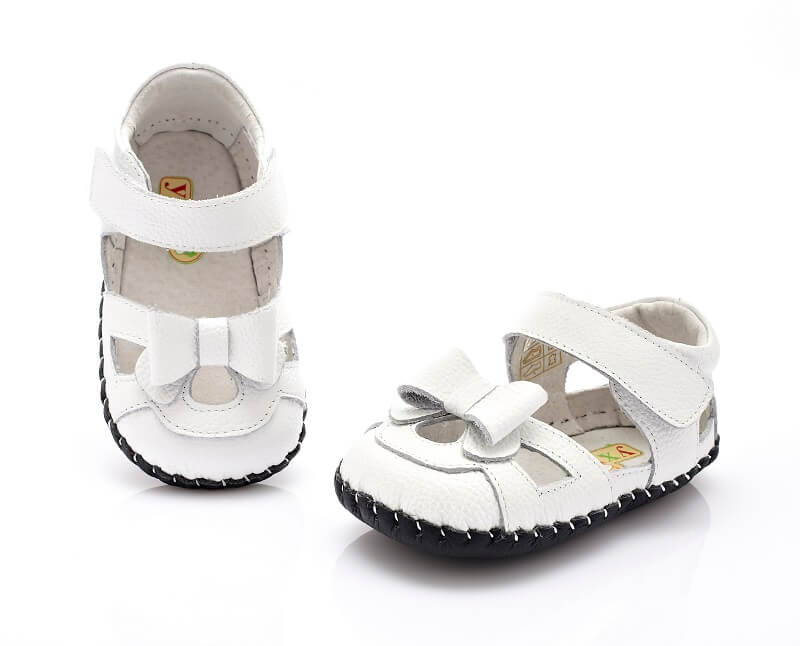 Emma baby girl sandals white with bow top and front view