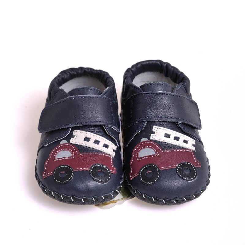 Navy baby boy sneakers with fire truck detail front view