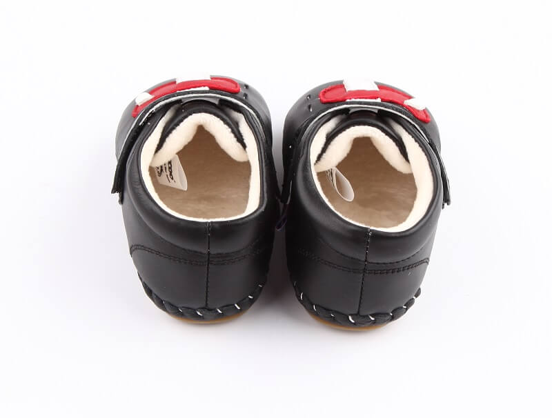 Black leather Flying baby boots with airplane velcro closure and lining for warmth