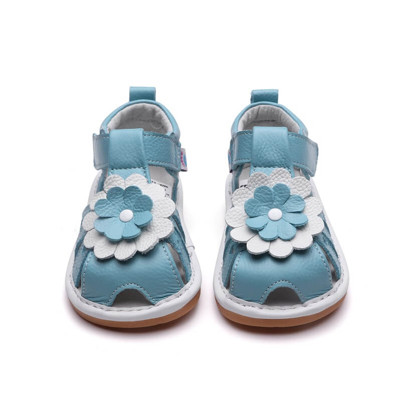 Gypsy blue leather toddler girl sandals with flower detail front view
