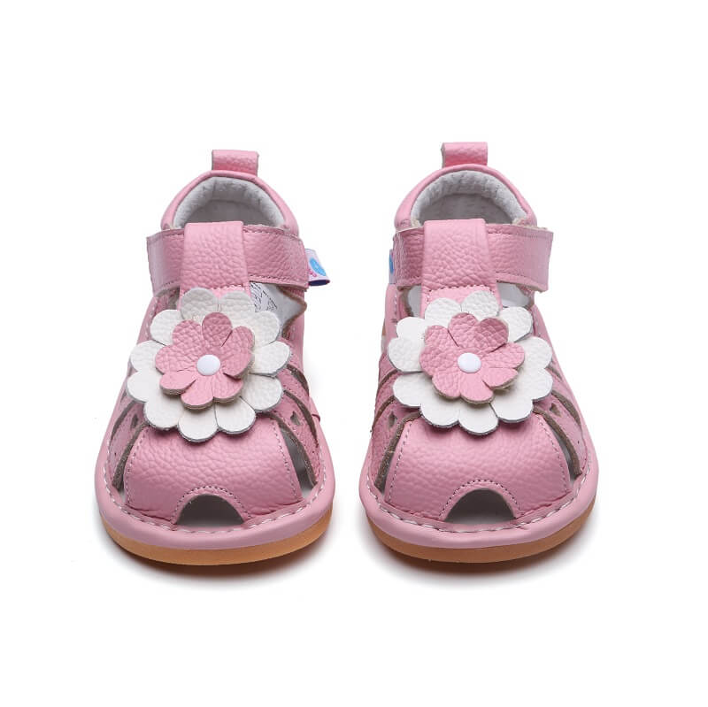 Gypsy pink leather toddler girl sandals with flower detail front view