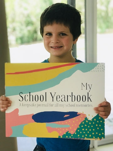 Image of happy kindy customer of My School Yearbook holding up the book