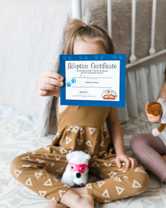Girl with birth certificate and plush polar bear