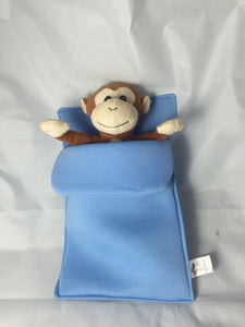 plush monkey in sleeping bag