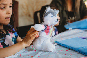Kids making plush Husky Dog Par-T-Pet