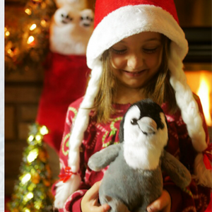 GIRL WITH PLUSH PENGUIN