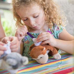 child stuffing her plush monkey at social distancing party