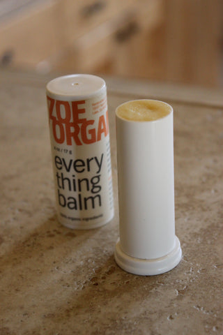 Adjust balm to be flush with the top rim of the balm tube. Place cap on tight.