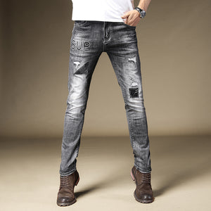 Land of Nostalgia Men's Skinny Denim Jeans with Embroidery Patches Letters