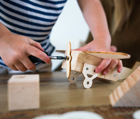 child using screwdriver kids carpentry build with me