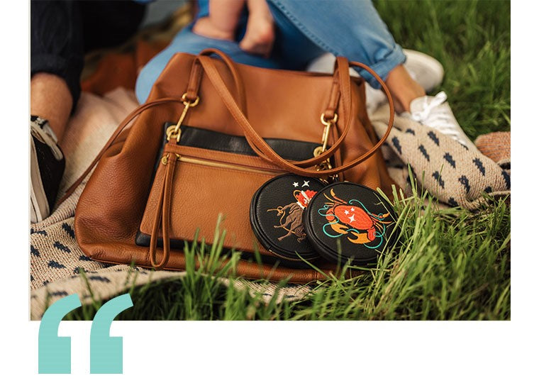 The Cancer Star Sign Revolve pouch with other HOBO GO accessories on a Kingston tote.