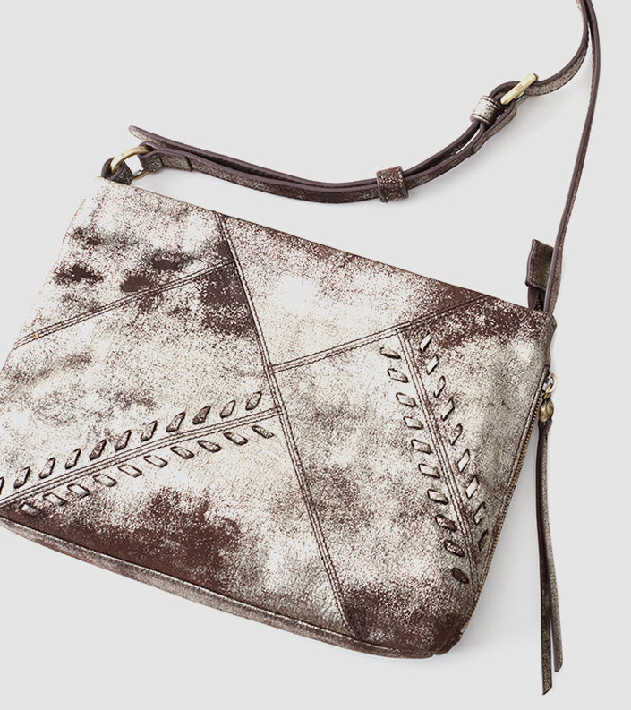 We love leather and this season we love it washed in metallics