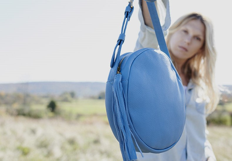 Shop the Groove Crossbody in the color of the year, blue!