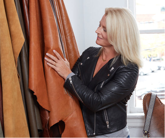 Koren Ray hand seleting leather hides for Hobo bags.