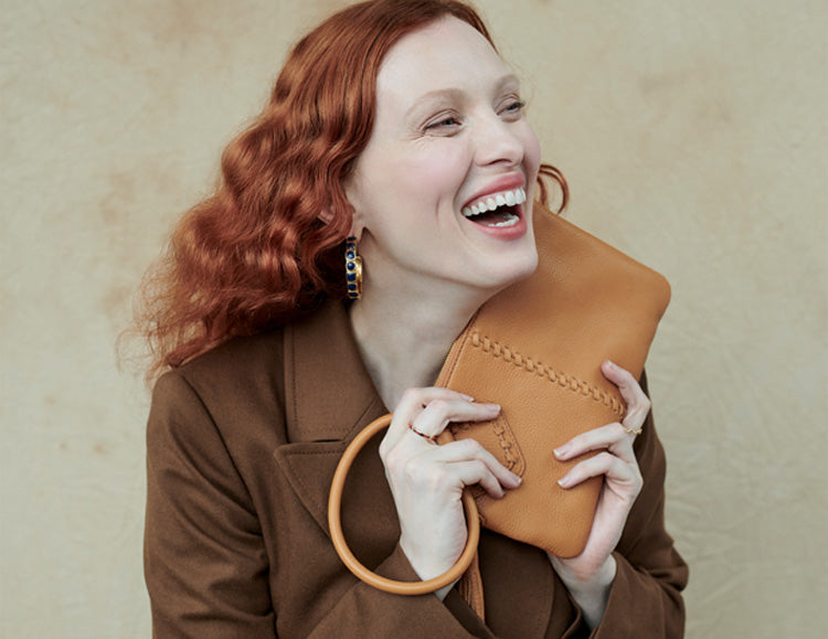 Karen Elson and the Sable wristlet