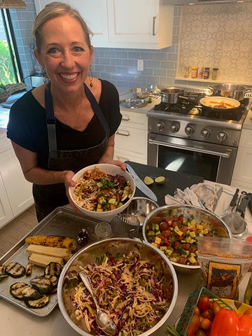 Chef Julie Frans holds a finished Summer BBQ Bowl.