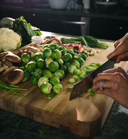 Cutting brussels sprouts on a large boos block cutting board