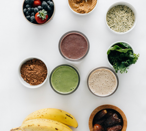 ingredients to make smoothies and 3 prepared smoothies