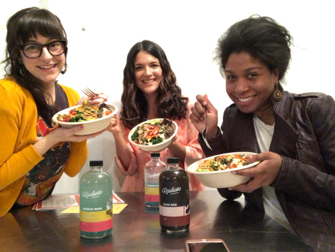 Photo with Dana and her 2 team members at the cooking class, holding up their bowls.