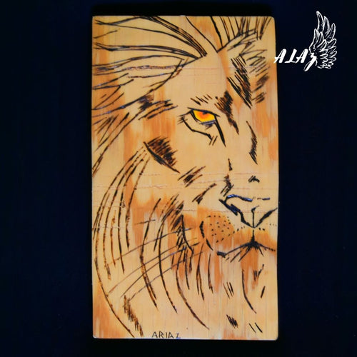 Lion eye Pyrography and Acrylic painting artwork by Nancy Alvarez and Mateo Ariaz