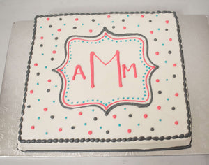 MaArthur's Bakery Custom Cake with Monongram Inside a Plaque and Polka Dots