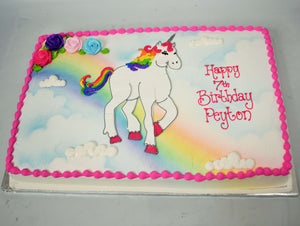 Unicorn Standing on a Rainbow Cake