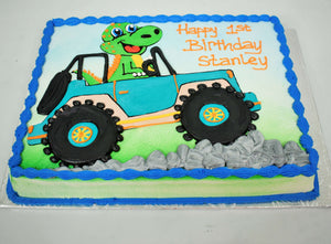 MaArthur's Bakery Custom Cake with a Green Dinasour Driving a Jeep